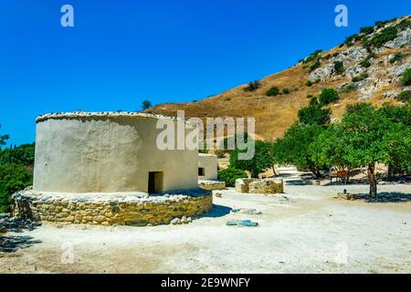 Reconstructed neolithic dwellings at Choirokoitia, Cyprus - Stock Photo