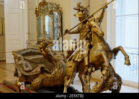 Carnival sleigh with the Figurine of St George in the exhibition of 18th century Russian culture in Winter Palace, the State Hermitage museum, St. Petersburg, Russia - Stock Photo