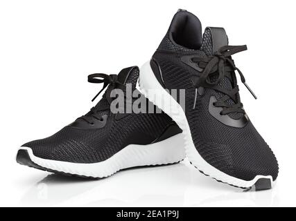 Pair of new unbranded black sport running shoes or sneakers isolated on white background with clipping path - Stock Photo