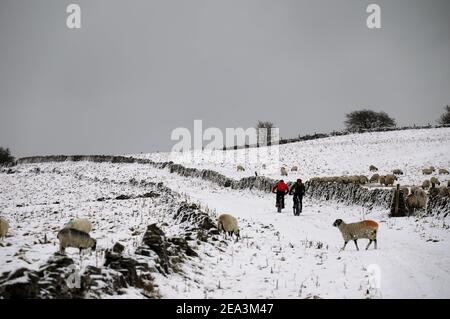 Winter bike ride over Longstone Edge in the Derbyshire Peak District National Park