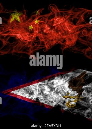 China, Chinese vs United States of America, America, US, USA, American, American Samoa smoky mystic flags placed side by side. Thick colored silky abs - Stock Photo