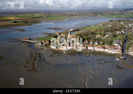 Scenic old English Village of Bosham in West Sussex aerial photo with the Church and old English Cottages.