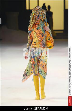 © Java/ABACA. 56739-17. ParisFrance, March 3, 2004. A model displays a creation by Japanese fashion designer Issey Miyake for his Fall-Winter 2004-2005 Ready-to-Wear collection presentation.