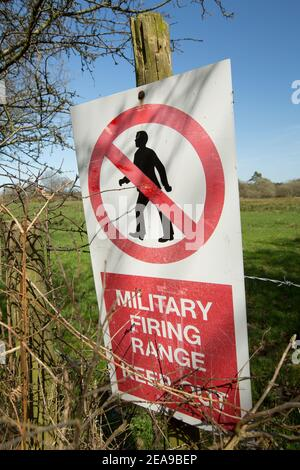 Signs on the boundary of a military firing range warning people to keep out. Dorset England UK GB