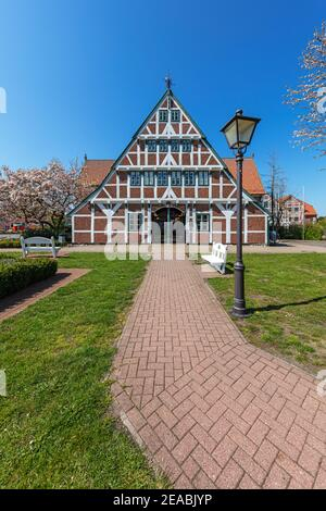 Tree blossom, half-timbered house, town hall in Jork, Altes Land, Stade district, Lower Saxony, - Stock Photo