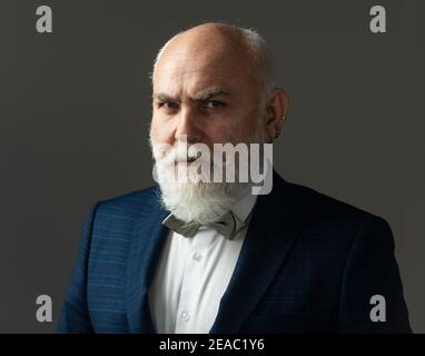 Serious Senior Man. Bearded middle-aged man with a serious expression in a closeup head and shoulders portrait.