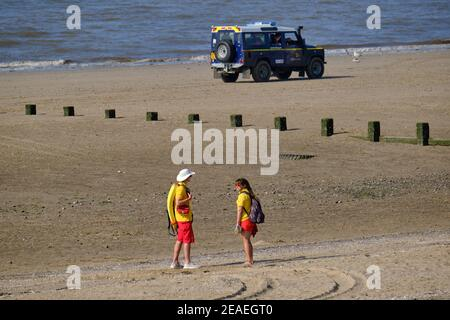 The RNLI Beach Patrol for Rhyl, Wales keeps the beach clear ready for the Air Show - Stock Photo
