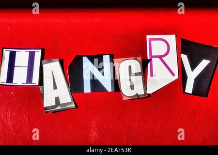 TheWord 'Hangry' using cut-out paper letters in the ransom note effect typography on a Red Background