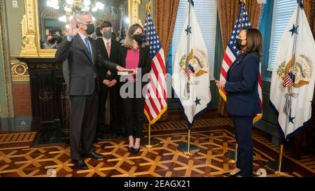 Washington, United States Of America. 09th Feb, 2021. U.S. Vice President Kamala Harris, right, performs a ceremonial swearing in of Denis McDonough as Secretary of Veterans Affairs, as his wife Kari McDonough holds a Bible, in the Eisenhower Executive Office Building at the White House February 9, 2021 in Washington, DC. Credit: Planetpix/Alamy Live News