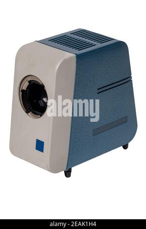 Vintage projector. Close-up of a old blue gray projector for viewing slides and filmstripes isolated on a white background. Entertainment last century to look holiday pictures on a projection screen. Macro. - Stock Photo