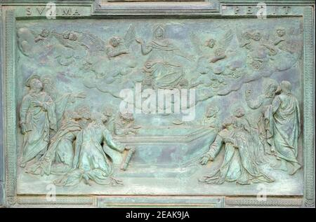 Assumption of the Virgin Mary, panel from Giambologna's school, collocated in the central portal of the Cathedral St. Mary of the Assumption in Pisa, Italy
