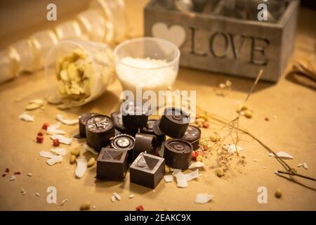 Handmade candies with fresh and dried fruits on light paper background
