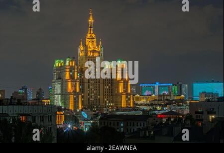 Moscow night. High-rise building on Kudrinskaya square near the Barrikadnaya metro station. Architecture of Soviet time - Stock Photo