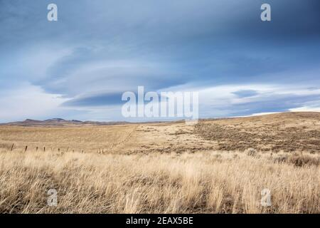 Lenticular clouds over the rolling landscape, near Milligan Canyon, in Jefferson County, Montana