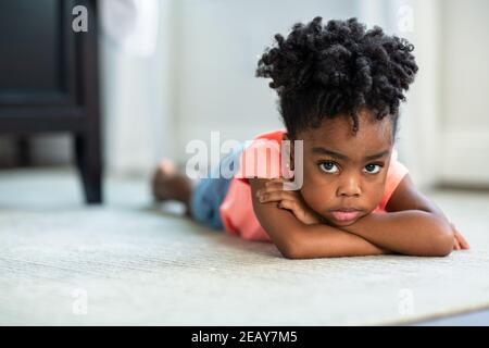 Young African American little girl upset and pouting.