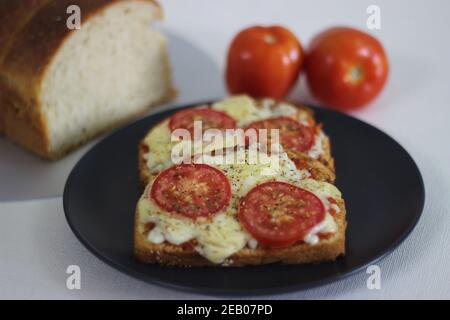 Pizza toast with home baked bread loaf. Shot on white background.