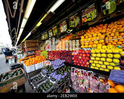 A vegetable and fruit stand at a bodega market in Manhattan New York. - Stock Photo