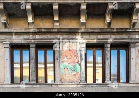Udine, Italy. February 11, 2020. the facade of the Sabbadini House, built in the 16th century with the fresco of Jupiter, painted by G.B. Bassi