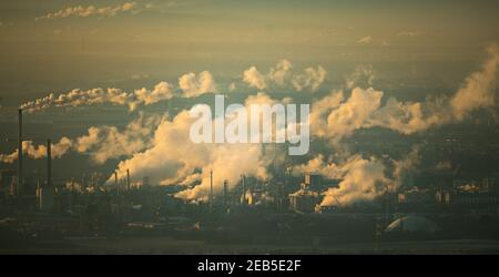Hessen, Königstein-Falkenstein, 12 Feb 2021: White clouds of smoke rise from the industrial facilities in Industriepark Höchst in the early morning in freezing temperatures. Photo: Arne Dedert/dpa Credit: dpa picture alliance/Alamy Live News