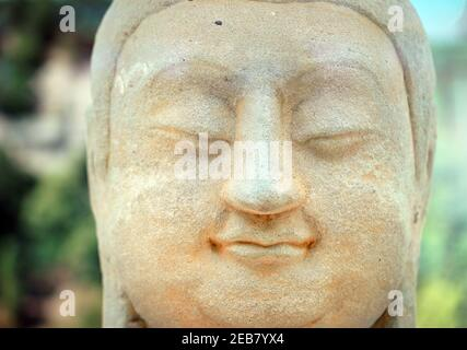 (210212) -- BEIJING, Feb. 12, 2021 (Xinhua) -- Photo taken on Feb. 12, 2021 shows part of a stone Buddha head of a statue in Cave 8 of the Tianlongshan Grottoes during an exhibition at Luxun Museum in Beijing, capital of China. A stone Buddha head that was stolen from China almost a century ago and recently retrieved has appeared at an exhibition at Beijing Luxun Museum starting from Friday, which is the Chinese Lunar New Year. The Buddha head belongs to one of the many stone statues in north China's Tianlongshan Grottoes, in the city of Taiyuan in Shanxi Province. It was the 100th relic re