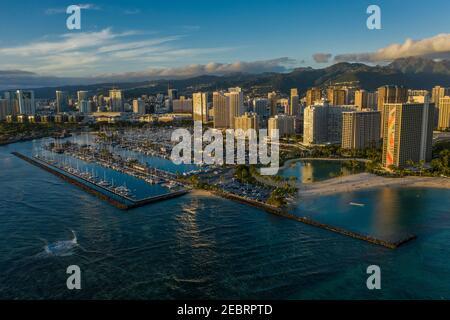 Ala Wai Harbor nad hotels at dusk, Oahu, Hawaii. Stock Photo
