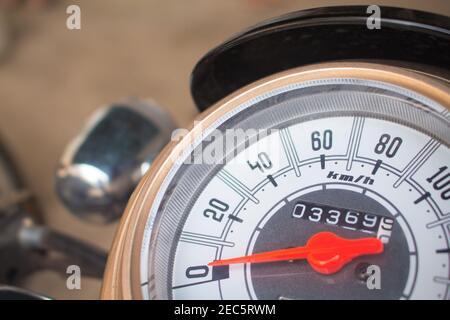 Speedometer on motorcycle dashboard. Round speedometer with red arrow. Speed zero shown. Full stop of motorbike. Transport closeup photo. Motorbike el