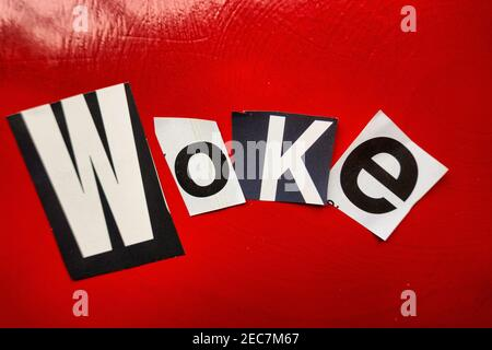 The word 'WOKE' using cut-out paper letters in the ransom note effect typography, USA