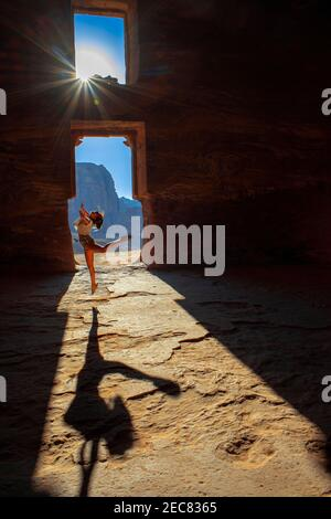 Dancing inside The Corinthian Tomb and the Palace Tomb of the Royal Tombs in the rock city of Petra. The Urn Tomb of the Royal Tombs in the rock city