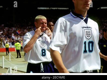 Football - 1996 European Championships - Euro 96 Quarter Final - England v Spain - Wembley Stadium - 22/6/96  England's Paul Gascoigne pulls faces and clowns around as he takes to the field  Mandatory Credit: Action Images  FILM