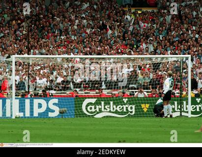 Football - 1996 European Championships - Euro 96 Quarter Final - England v Spain - Wembley Stadium - 22/6/96  England's Paul Gascoigne sends Spain's Antonio Zubizarreta the wrong way to score his penalty in the shoot out  Mandatory Credit: Action Images  FILM