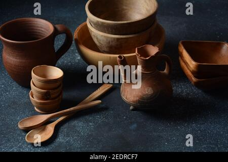 Culinary background  : empty ceramic plates, wooden or bamboo spoons and bowls   . Rustic style. Home Kitchen Decor.