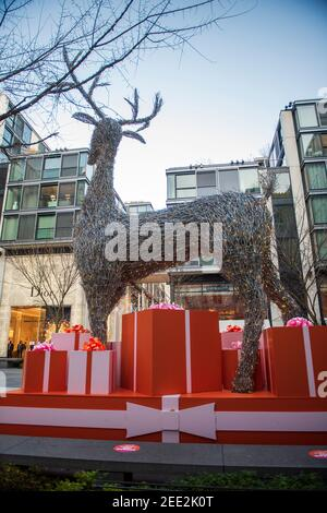 Palmer Alley in Washington DC City Center is decorated with a giant reindeer and extra large gift packages for the winter holiday season. - Stock Photo