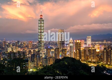 Taipei City skyline illuminated during a beautiful sunset. Panoramic view from the Mount Elephant in Taipei. - Stock Photo