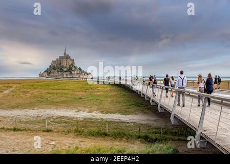 Mont Saint-Michel, France; July 24th 2020 - Vistors walking towards Mont Saint-Michel, Normandy, France