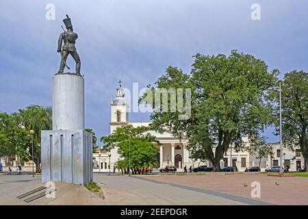 Statue of sergeant Juan Cabral and colonial cathedral at the Plaza Sargento Cabral, main square in the city Corrientes, Corrientes Province, Argentina