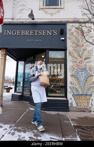 Curbside order with masked delivery of lutefisk from the Ingebretsen's Nordic Market Place during Covid Pandemic. Minneapolis Minnesota MN USA