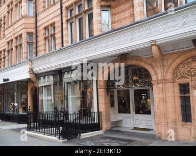 London, UK - September 27, 2016:  In the Mayfair district, elegant designer shops in an ornate old building.