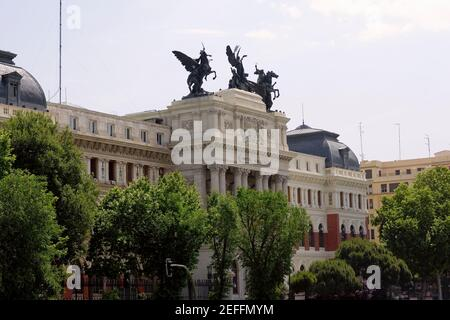 Trees in front of a government building, Ministry Of Agriculture Building, Madrid, Spain