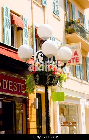 Lamppost in front of a building, Nice, France - Stock Photo