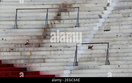 Birds fly over the stands of the Estadio Monumental Antonio Vespucio Liberti during restoration works ahead of its reopening, in Buenos Aires, Argentina February 18, 2021. REUTERS/Agustin Marcarian