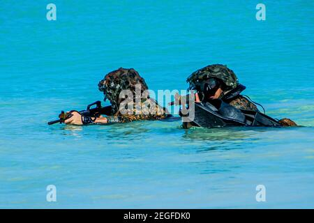 U.S. Marines with 1st Battalion, 3rd Marines, during reconnaissance scout swimmer training at Training Area Bellows February 8, 2021 in Waimanalo, Hawaii. Stock Photo