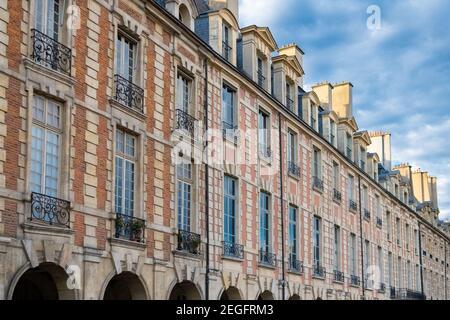 Paris, place des Vosges, beautiful buildings with a public park