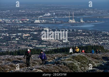 Co. Dublin, Ireland - January 23: People hiking during covid pandemic to see unusual Irish winter and mountain landscapes. Seen from Fairy Castle