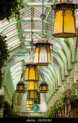 Interior of the Royal Arcade In Norwich Norfolk, showing the Art Nouveau hanging lights. - Stock Photo
