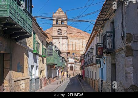 Street with colonial houses and bell tower of the San Francisco of Potosi Temple and Convent in the city Potosi, Tomás Frías Province, Bolivia