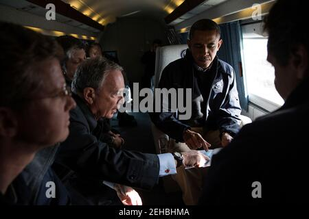 Nov. 15, 2012 New York City Mayor Michael Bloomberg views a map with the President during an aerial tour to view damage from Hurricane Sandy in Breezy Point, the Rockaways and Staten Island in NYC. Also onboard were New York Gov. Andrew Cuomo, Shaun Donovan, Secretary of Housing and Urban Development, and Janet Napolitano, Homeland Security Secretary. - Stock Photo