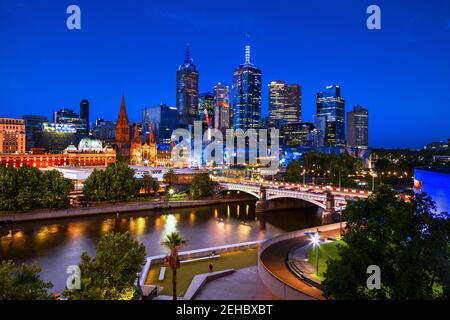 Melbourne, Australia skyline at night: Looking across the Yarra River to Princes Bridge and Federation Square.