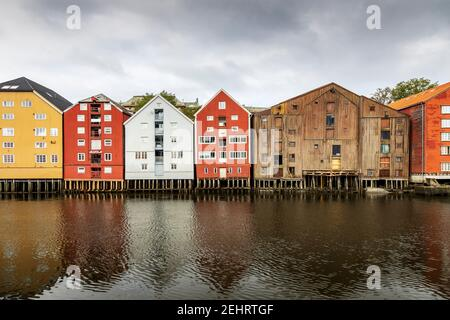 Colourful buildings along the river nidelva, in Trondheim, Norway.