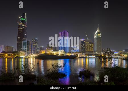 Modern architecture in downtown of Ho Chi Minh City, with river Saigon at night