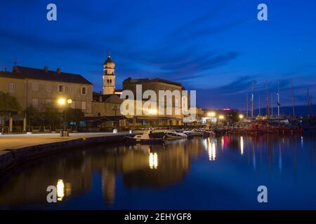 Night Photografy of City of Krks Empty Street next to a Boat Port - Stock Photo